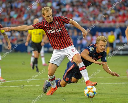 Stock Image of AC Milan defender, Ivan Strinic (23), and Bayern forward, Fiete Arp (15), clash while working for ball control during the International Champions Cup match between AC Milan and FC Bayern, at Children's Mercy Park in Kansas City, KS. Bayern defeated AC Milan, 1-0. Kevin Langley/Sports South Media/CSM
