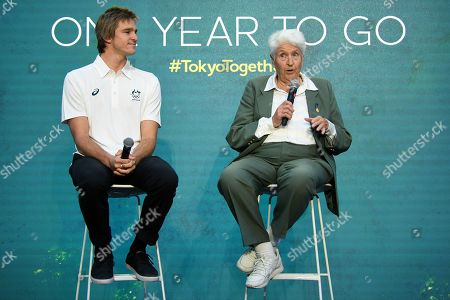 Stock Image of Surfer Ryan Callinan (L) and former Olympic swimmer Dawn Fraser (R) speak on stage during the One Year to Go to Tokyo 2020 Olympic Games Media Event at the Qantas Headquarters in Sydney, Australia, 24 July 2019.