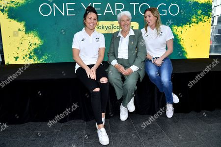 Modern pentathlon competitor Chloe Esposito (L) former Olympic swimmer Dawn Fraser (C) and Hurdler Sally Pearson (R) pose for a photo during the One Year to Go to Tokyo 2020 Olympic Games Media Event at the Qantas Headquarters in Sydney, Australia, 24 July 2019.