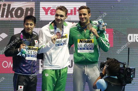 Gold medalist Kristof Milak (C) of Hungary is flanked on the podium by silver medalist Daiya Seto (L) of Japan and bronze medal winner Chad le Clos of South Africa during the medal ceremony for the men's 200m Butterfly final of the swimming competitions at the Gwangju 2019 Fina World Championships, Gwangju, South Korea, 24 July 2019.