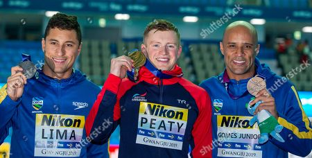 (L-R) Second placed Felipe Lima of Brazil, winner Adam Peaty of Great Britain and third placed Joao Gomes Junior of Brazil pose with their medals after the medal ceremony for the men's 50m Breaststroke Final during the Swimming events at the Gwangju 2019 FINA World Championships, Gwangju, South Korea, 24 July 2019.