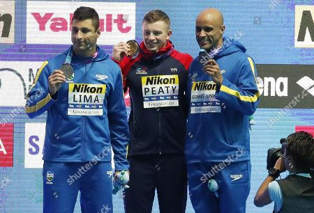 Gold medalist Adam Peaty (C) of Great Britain is flanked on the podium by silver medalist Felipe Lima (L) of Brazil and bronze medal winner Joao Gomes Junior of Brazil during the medal ceremony for the men's 50m Breaststroke final of the swimming competitions at the Gwangju 2019 Fina World Championships, Gwangju, South Korea, 24 July 2019.