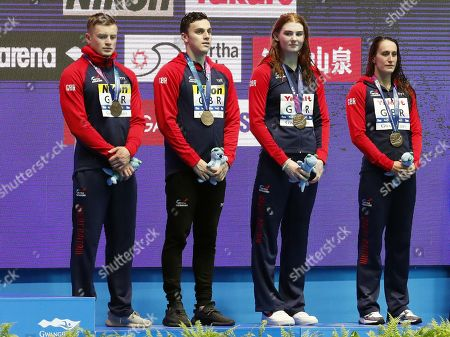 Stock Photo of (from L) Bronze medalists Adam Peaty, James Guy, Freya Anderson and Georgia Davies of Great Britain on the podium during the medal ceremony for the Mixed 4x100m Medley Relay final of the swimming competitions at the Gwangju 2019 Fina World Championships, Gwangju, South Korea, 24 July 2019.