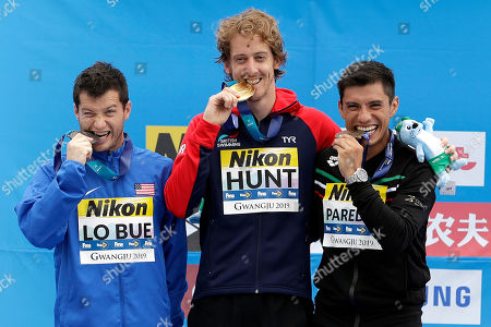 Stock Picture of From left, silver medalist Steve Lo Bue of the United States, gold medalist Gary Hunt of Britain, and bronze medalist Jonathan Paredes of Mexico stand on the podium after the men's high diving competition at the World Swimming Championships in Gwangju, South Korea