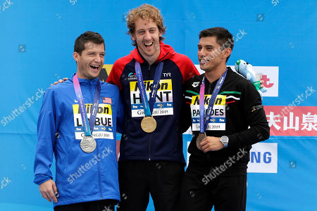 Stock Photo of From left, silver medalist Steve Lo Bue of the United States, gold medalist Gary Hunt of Britain, and bronze medalist Jonathan Paredes of Mexico stand on the podium after the men's high diving competition at the World Swimming Championships in Gwangju, South Korea