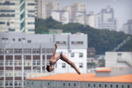 Gary Hunt of Britain dives during the men's high diving competition at the World Swimming Championships in Gwangju, South Korea