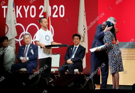IOC President Thomas Bach (2-R) celebrates Chief of Mission of the Tokyo 2020 Refugee Olympic Team Tegla Loroupe (R) after presenting invitation for Tokyo 2020 Olympic Games during the One Year to Go Ceremony at Tokyo Forum in Tokyo, Japan, 24 July 2019. The Tokyo Organising Committee of the Tokyo 2020 Olympic and Paralympic Games held the One Year to Go Ceremony to mark one year until the opening of the Tokyo 2020 Olympic Games, which will open on 24 July 2020 through 09 August 2019.