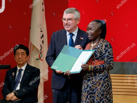 IOC President Thomas Bach (L) presents invitation for Tokyo 2020 Olympic Games to Chief of Mission of the Tokyo 2020 Refugee Olympic Team Tegla Loroupe during the One Year to Go Ceremony at Tokyo Forum in Tokyo, Japan, 24 July 2019. The Tokyo Organising Committee of the Tokyo 2020 Olympic and Paralympic Games held the One Year to Go Ceremony to mark one year until the opening of the Tokyo 2020 Olympic Games, which will open on 24 July 2020 through 09 August 2019.