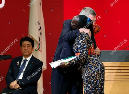 IOC President Thomas Bach (L) celebrates Chief of Mission of the Tokyo 2020 Refugee Olympic Team Tegla Loroupe after presenting invitation for Tokyo 2020 Olympic Games during the One Year to Go Ceremony at Tokyo Forum in Tokyo, Japan, 24 July 2019. The Tokyo Organising Committee of the Tokyo 2020 Olympic and Paralympic Games held the One Year to Go Ceremony to mark one year until the opening of the Tokyo 2020 Olympic Games, which will open on 24 July 2020 through 09 August 2019.