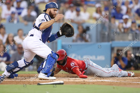Los Angeles Angels second baseman Luis Rengifo (4) scores on a play at the plate as Los Angeles Dodgers catcher Russell Martin (55) waits for the throw during the game between the Los Angeles Angels of Anaheim and the Los Angeles Dodgers at Dodger Stadium in Los Angeles, CA. (Photo by Peter Joneleit)