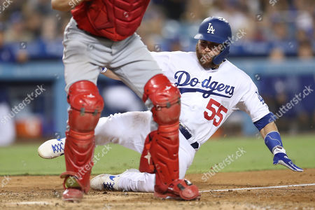 Los Angeles Dodgers catcher Russell Martin (55) slides into home plate but not in time to beat the force out during the game between the Los Angeles Angels of Anaheim and the Los Angeles Dodgers at Dodger Stadium in Los Angeles, CA. (Photo by Peter Joneleit)