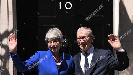 Theresa May and Philip May wave following her farewell speech in Downing Street