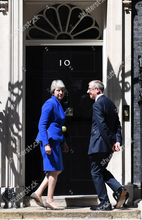 Theresa May and Philip May stand outside Number 10 following her farewell speech in Downing Street