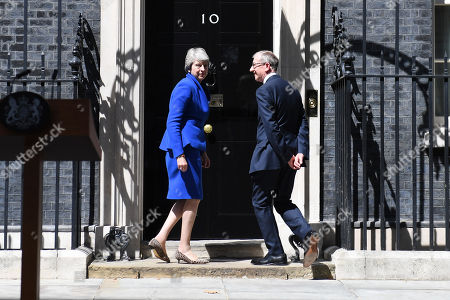 Theresa May and Philip May outside Number 10 following her farewell speech in Downing Street