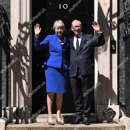 Theresa May and Philip May wave outside Number 10 following her farewell speech in Downing Street