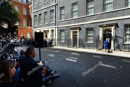 Theresa May and Philip May leave No.10 Downing Street.