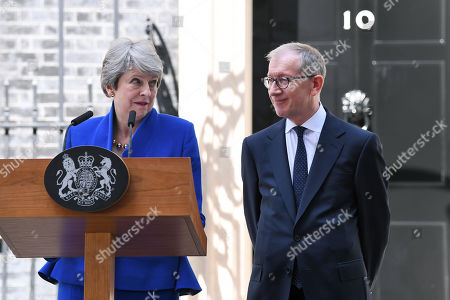 Theresa May delivers her farewell speech in Downing Street alongside Philip May