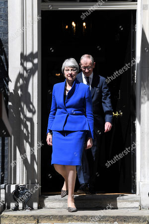 Theresa May and Philip May step out from Number 10 Downing Street