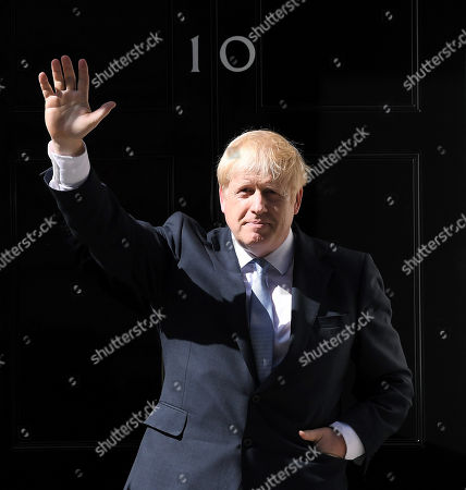 Boris Johnson waves outside number 10 after delivering his first speech as Prime Minister in Downing Street