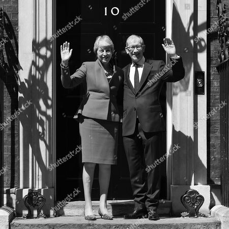 Theresa May and Philip May wave outside Number 10 following her resignation speech in Downing Street