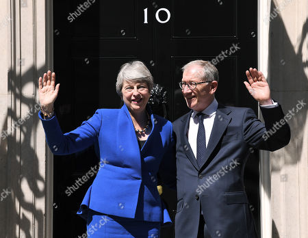 Stock Picture of Theresa May and Philip May wave outside Number 10 following her resignation speech in Downing Street