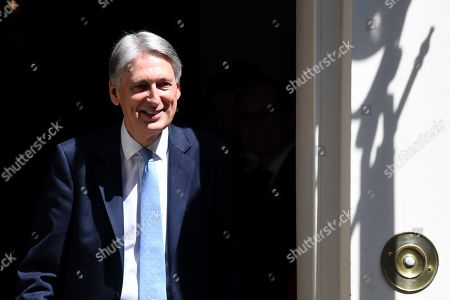Philip Hammond leaves No.11 Downing Street.