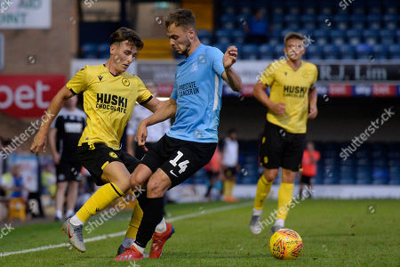 Brandon Goodship  of Southend United and Danny McNamara of Millwall in action during the pre season friendly between Southend United and Millwall at Roots Hall in Southend, UK. 24th July 2019