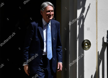 British Chancellor of the Exchequer Phillip Hammond leaves Downing Street for the Prime Minister's Question (PMQs) at parliament in London, Britain, 24 July 2019. Theresa May is stepping down as British Prime Minister following her resignation as Conservative Party leader on 07 June. Former London mayor and foreign secretary Boris Johnson is taking over the post after he was elected party leader the previous day.