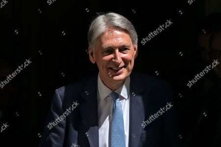British Chancellor of the Exchequer Phillip Hammond leaves Downing Street for the Prime Minister's Questions (PMQs) at parliament in London, Britain, 24 July 2019. Theresa May is stepping down as British Prime Minister following her resignation as Conservative Party leader on 07 June. Former London mayor and foreign secretary Boris Johnson is taking over the post after he was elected party leader the previous day.