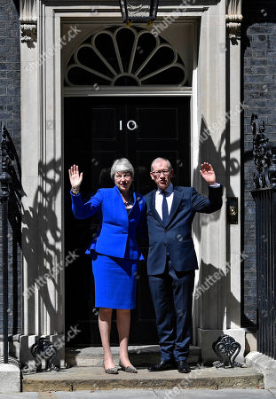 British Prime Minister Theresa May (L) and her husband Phillip (R) wave outside 10 Downing Street next to her husband Philip following her last Prime Minister's Questions (PMQs) and before departing to Buckingham Palace in London, Britain, 24 July 2019. Theresa May is stepping down as British Prime Minister following her resignation as Conservative Party leader on 07 June. Former London mayor and foreign secretary Boris Johnson is taking over the post after he was elected party leader the previous day.