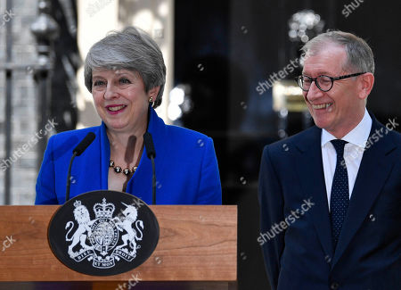 British Prime Minister Theresa May (L) and her husband Phillip (R) react during her statement outside 10 Downing Street following her last Prime Minister's Questions (PMQs) and before departing to Buckingham Palace in London, Britain, 24 July 2019. Theresa May is stepping down as British Prime Minister following her resignation as Conservative Party leader on 07 June. Former London mayor and foreign secretary Boris Johnson is taking over the post after he was elected party leader the previous day.