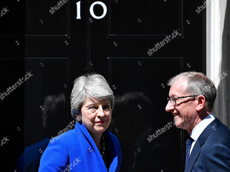 British Prime Minister Theresa May (L) and her husband Phillip (R) react on the steps of 10 Downing Street following her statement after her last Prime Minister's Questions (PMQs) and before departing to Buckingham Palace in London, Britain, 24 July 2019. Theresa May is stepping down as British Prime Minister following her resignation as Conservative Party leader on 07 June. Former London mayor and foreign secretary Boris Johnson is taking over the post after he was elected party leader the previous day.