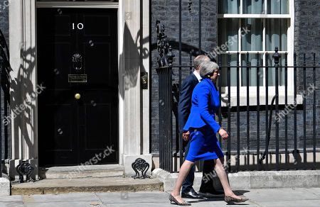 British Prime Minister Theresa May (R) and her husband Phillip (L) leave 10 Downing Street in London, Britain, 24 July 2019. Theresa May is stepping down as British Prime Minister following her resignation as Conservative Party leader on 07 June. Former London mayor and foreign secretary Boris Johnson is taking over the post after he was election as Tories party leader was announced the previous day.