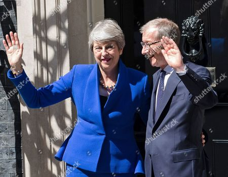 British Prime Minister Theresa May (L) and her husband Phillip (R) wave outside 10 Downing Street following her last Prime Minister's Questions (PMQs) and before departing to Buckingham Palace in London, Britain, 24 July 2019. Theresa May is stepping down as British Prime Minister following her resignation as Conservative Party leader on 07 June. Former London mayor and foreign secretary Boris Johnson is taking over the post after he was elected party leader the previous day.