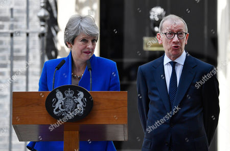 British Prime Minister Theresa May (L) gives a statement nexto to her husband Phillip (R) outside 10 Downing Street following her statement after her last Prime Minister's Questions (PMQs) and before departing to Buckingham Palace in London, Britain, 24 July 2019. Theresa May is stepping down as British Prime Minister following her resignation as Conservative Party leader on 07 June. Former London mayor and foreign secretary Boris Johnson is taking over the post after he was elected party leader the previous day.