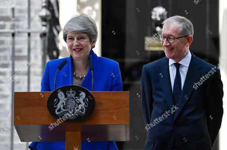 British Prime Minister Theresa May (L) gives a statement next to her husband Phillip (R) outside 10 Downing Street following her statement after her last Prime Minister's Questions (PMQs) and before departing to Buckingham Palace in London, Britain, 24 July 2019. Theresa May is stepping down as British Prime Minister following her resignation as Conservative Party leader on 07 June. Former London mayor and foreign secretary Boris Johnson is taking over the post after he was elected party leader the previous day.
