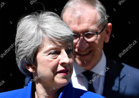British Prime Minister Theresa May and her husband Phillip (R) leave 10 Downing Street before departing to Buckingham Palace in London, Britain, 24 July 2019. Theresa May is stepping down as British Prime Minister following her resignation as Conservative Party leader on 07 June. Former London mayor and foreign secretary Boris Johnson is taking over the post after he was elected party leader the previous day.