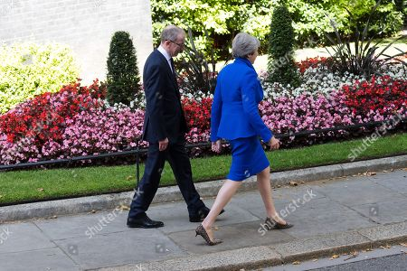 British Prime Minister Theresa May (R) and her husband Phillip (L) leave Downing Street for Buckingham Palace in London, Britain, 24 July 2019. Theresa May is stepping down as British Prime Minister following her resignation as Conservative Party leader on 07 June. Former London mayor and foreign secretary Boris Johnson is taking over the post after he was election as Tories party leader was announced the previous day.