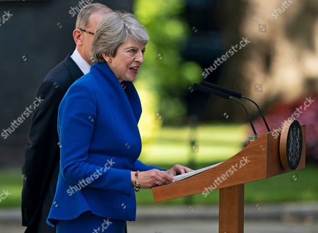 British Prime Minister Theresa May (front) gives a statement next to her husband Phillip (back) outside 10 Downing Street following her last Prime Minister's Questions (PMQs) and before departing to Buckingham Palace in London, Britain, 24 July 2019. Theresa May is stepping down as British Prime Minister following her resignation as Conservative Party leader on 07 June. Former London mayor and foreign secretary Boris Johnson is taking over the post after he was elected party leader the previous day.