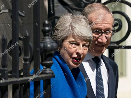 British Prime Minister Theresa May (L) and her husband Phillip (R) smile for a picture outside 10 Downing Street after her statement following her last Prime Minister's Questions (PMQs) and before departing to Buckingham Palace in London, Britain, 24 July 2019. Theresa May is stepping down as British Prime Minister following her resignation as Conservative Party leader on 07 June. Former London mayor and foreign secretary Boris Johnson is taking over the post after he was elected party leader the previous day.