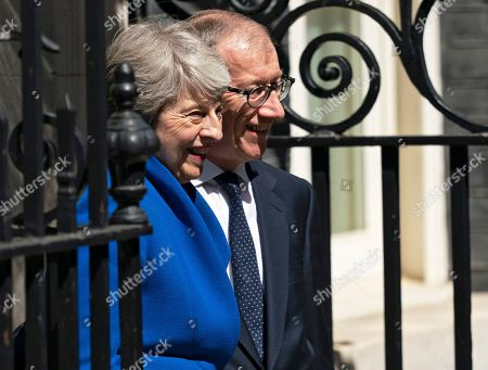 Stock Image of British Prime Minister Theresa May (L) and her husband Phillip (R) smile for a picture outside 10 Downing Street after her statement following her last Prime Minister's Questions (PMQs) and before departing to Buckingham Palace in London, Britain, 24 July 2019. Theresa May is stepping down as British Prime Minister following her resignation as Conservative Party leader on 07 June. Former London mayor and foreign secretary Boris Johnson is taking over the post after he was elected party leader the previous day.