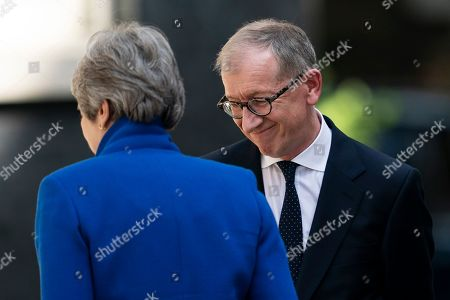 Stock Picture of British Prime Minister Theresa May (L) and her husband Phillip (R) smile outside 10 Downing Street after her statement following her last Prime Minister's Questions (PMQs) and before departing to Buckingham Palace in London, Britain, 24 July 2019. Theresa May is stepping down as British Prime Minister following her resignation as Conservative Party leader on 07 June. Former London mayor and foreign secretary Boris Johnson is taking over the post after he was elected party leader the previous day.