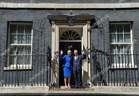 British Prime Minister Theresa May (L) and her husband Phillip (R) wave from the steps of 10 Downing Street after her statement prior to departing to Buckingham Palace in London, Britain, 24 July 2019. Theresa May is stepping down as British Prime Minister following her resignation as Conservative Party leader on 07 June. Former London mayor and foreign secretary Boris Johnson is taking over the post after he was election as Tories party leader was announced the previous day.