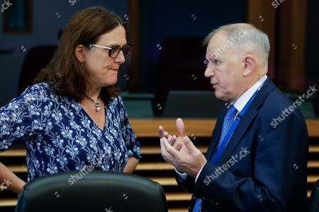 European Commissioner for Trade Cecilia Malmstrom (L) and EU Commissioner for Health and Food safety Vytenis Andriukaitis at the start of a weekly college meeting at the EU headquarters in Brussels, Belgium, 24 July 2019.