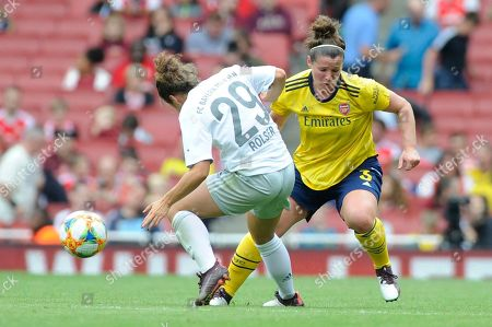 Stock Picture of Emma Mitchell of Arsenal Women and Nicole Rolser of Bayern Munich Women in action during the Emirates Cup match between Arsenal Women and Bayern Munich Women at the Emirates Stadium in London, UK - 28th July 2019