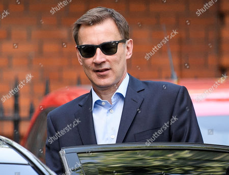 Jeremy Hunt is seen leaving his home in Westminster the morning after losing the Conservative party leadership election.
