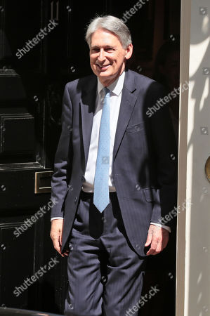 Philip Hammond leaves Downing Street for PMQs
