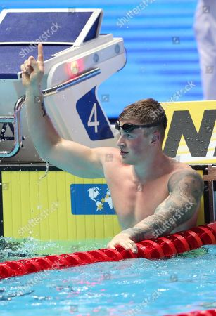 Adam Peaty of Great Britain reacts after winning in the men's 50m Breaststroke Final during the Swimming events at the Gwangju 2019 FINA World Championships, Gwangju, South Korea, 24 July 2019.