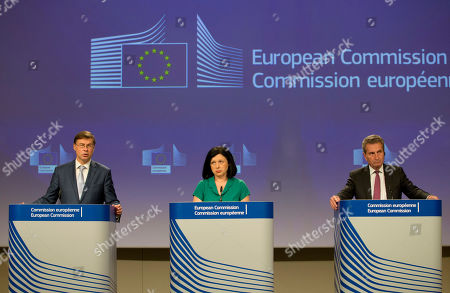 From left, European Commissioner for Euro and Social Dialogue Valdis Dombrovskis, European Commissioner for Justice Vera Jourova and European Commissioner for Budget and Human Resources Guenther Oettinger participate in a media conference at EU headquarters in Brussels, . The media conference was held for the EU to comment on the governance framework for the Budgetary Instrument for Convergence and Competitiveness, the Anti-Money Laundering Package and the application of the new data protection rules