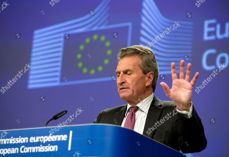 European Commissioner for Budget and Human Resources Guenther Oettinger speaks during a media conference at EU headquarters in Brussels, . The media conference was held for the EU to comment on the governance framework for the Budgetary Instrument for Convergence and Competitiveness, the Anti-Money Laundering Package and the application of the new data protection rules